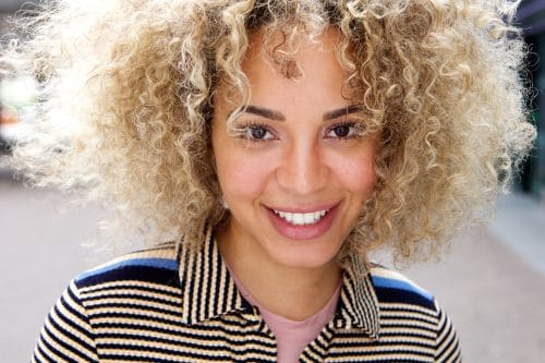 Close up portrait of healthy young woman smiling