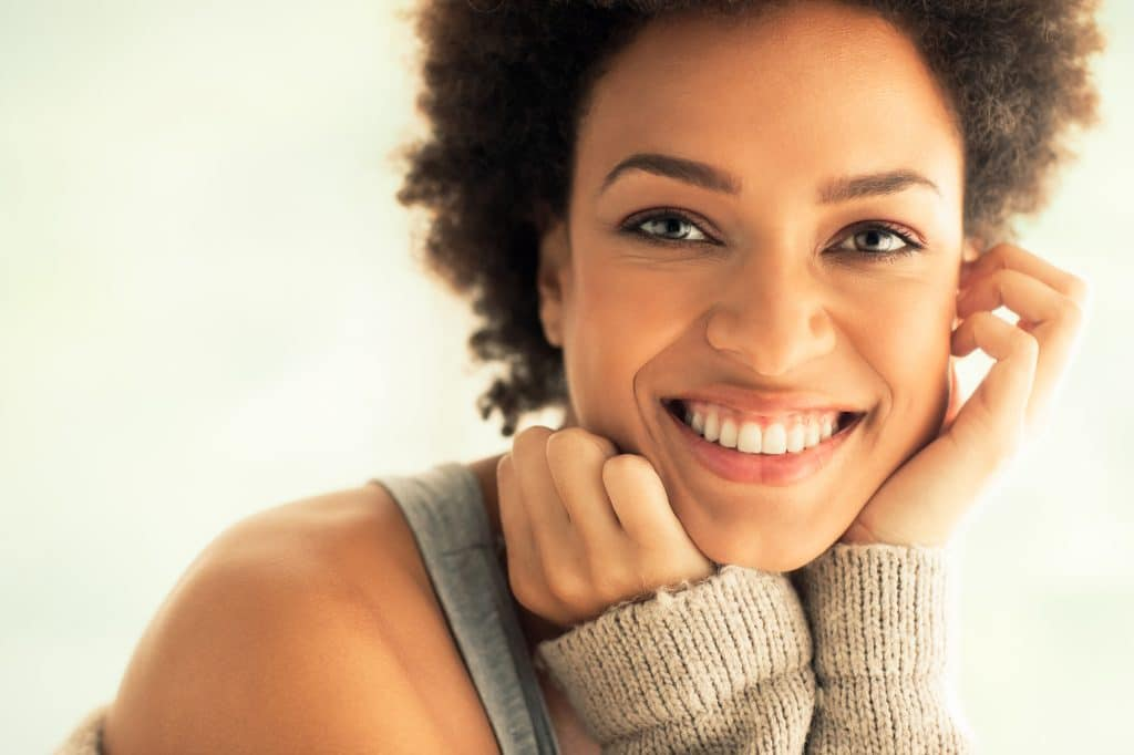 Beautiful young African woman smiling.